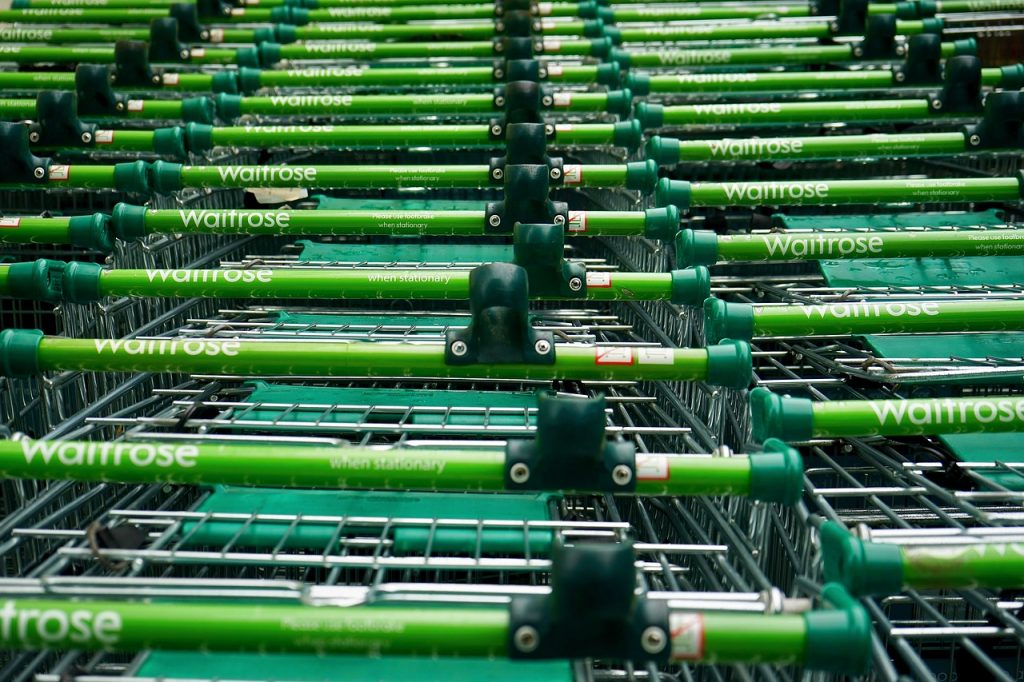 A line of Waitrose supermarket trolleys