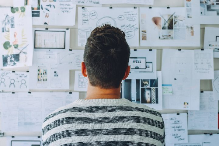Person looking at white board with ideas